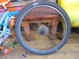 Rear bicycle wheel 26 x 2.2 with 7 speed cassette