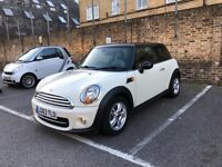 Pepper white exterior with the black roof and black&white interior. Leather seats