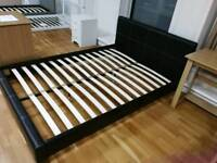 Leather double bed frame with sprung slats