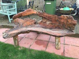 Solid teak root garden bench