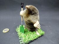 TAXIDERMY MOLE with garden spade of metal and wood. No. 44. 11 cm tall approx.