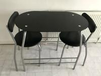 Black glass dining table for 2