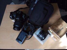 Nikon D50 + 18-55 and 50mm f/1.8 D Lens + Tripod + carrier bag.