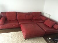 Faux red leather sofa