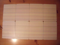 8 rectangular cork-backed place/table mats - muted yellow/oatmeal/brown stripe design. £4 ovno.