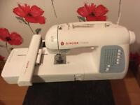 Singer futura XL 400 combined embroidery sewing machine used twice with added editing disc new