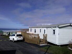 Sited in Perranporth,Cornwall with beautiful sea views.The 2 Bedroom caravan is 10mins walk to beach