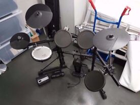 Roland TD-3 electronic drum kit with option for extra pads.