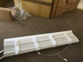White wooden blind with decorative tape
