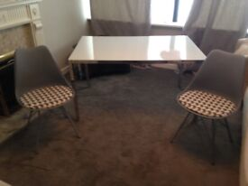 Smoked glass dining table and 6 chair set.