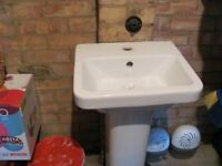 small basin and pedestal suitable for a cloakroom