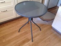 NEW Patio / Bistro Table Ideal for 2 people, tempered glass, dark grey frame.