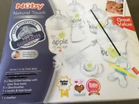 Nuby newborn part starter set, all still wrapped as never used