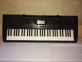 Casio CTK 3000 keyboard and stand.