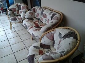 cane two seater setee and two chairs