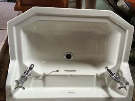 White traditional style sink with taps fixing rails