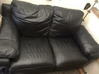 2 seater black leather sofa in good condition