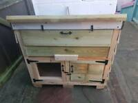 Rabbit hutch with storage at the top