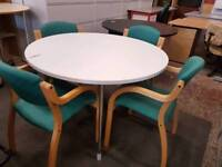 Office meeting table with 4 green chairs