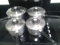 SET OF 4 SAUCEPANS IN REALLY GOOD CONDITION