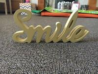 """Yellow """"smile"""" wooden sign"""