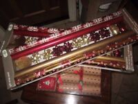 Christmas crackers and two rolls of wrapping paper brand new and sealed