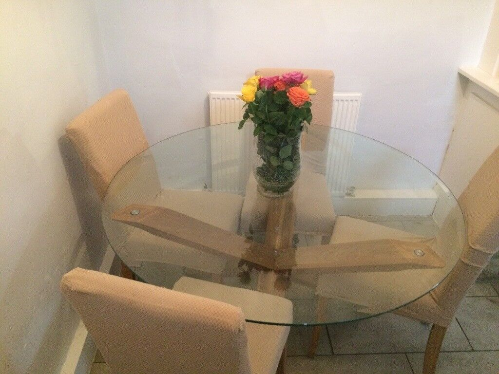 For sale Solid Oak dining table with glass