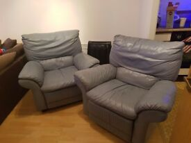 2 leather armchairs one is recliner very comfortable one has small rip on arm