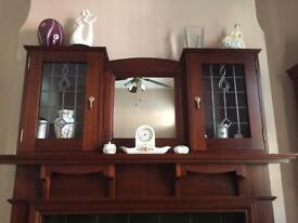 Mahogany fireplace surround with display cabinet.