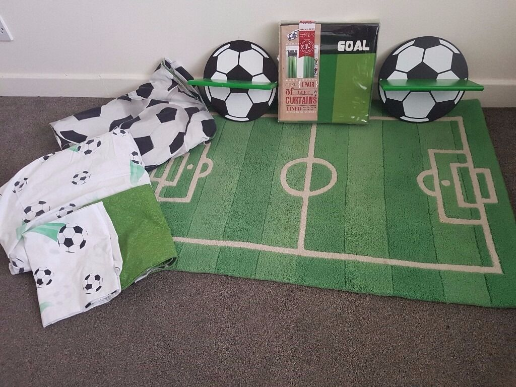"""Football Curtains, bedding trophy shelves and rugin Cookridge, West YorkshireGumtree - Football themed kids bedroom consisting of Football pitch rug (approx 42"""" x 28"""") Football curtains brand new never been opened 168cm width x 137 cm drop 2 x Football trophy shelves Duvet set quilt cover/sheet and 2 x pillowcases Ideal for your..."""