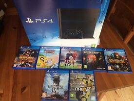 Sony PS4 with controller and 7 games