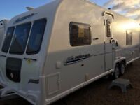 top of the range twin axel luxury touring caravan with quad movers