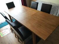 Extendable dining table and 5 leather chairs for sale delivery available
