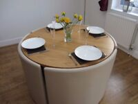 Space saving round dining table with 4 leather chairs
