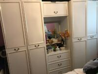 White Wardrobe cupboards with draws and mirror