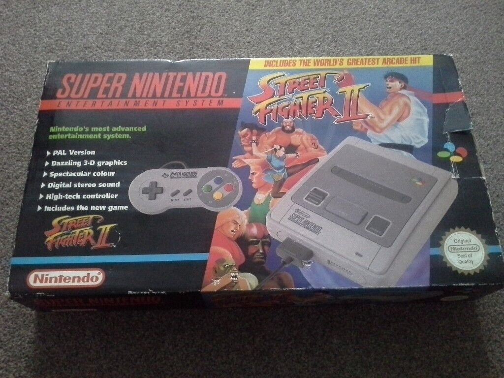 Original boxed snes console and street fighter 2