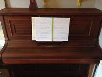 Well-loved upright piano going cheap! Suitable for beginner.