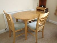 Light Oak kitchen table and three chairs