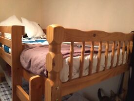 Wooden bunk bed for sale.