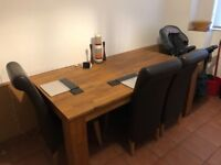 Dining table and six chairs with matching sideboards
