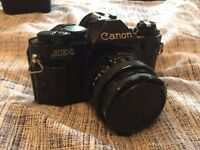 Rare Vintage Canon AE-1 with a 50mm 1.8 lens 35mm film camera. Excellent condition. Similar to A1