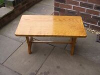 An Art Deco style polished coffee table.
