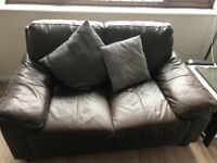 Two brown leather sofas, perfect for a first home