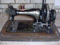 Vintage hand cranked sewing machine
