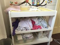 White baby changing table with space under for baskets etc