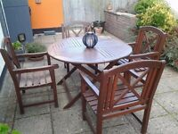 Garden table and chairs. Large solid wood. Good condition