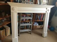 White wooden fire place surround.