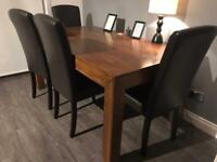 Wooden dining table and 4 leather chairs for sale