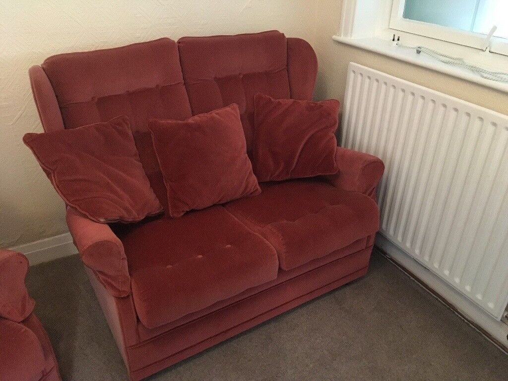 2x two seater sofa in pink dralon. Hardly used.