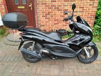2010 Honda PCX 125 scooter, new 1 year MOT, top box, very good runner, FREE HELMET, ride away ,,